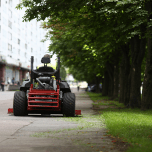 guy riding lawn mower at commercial property